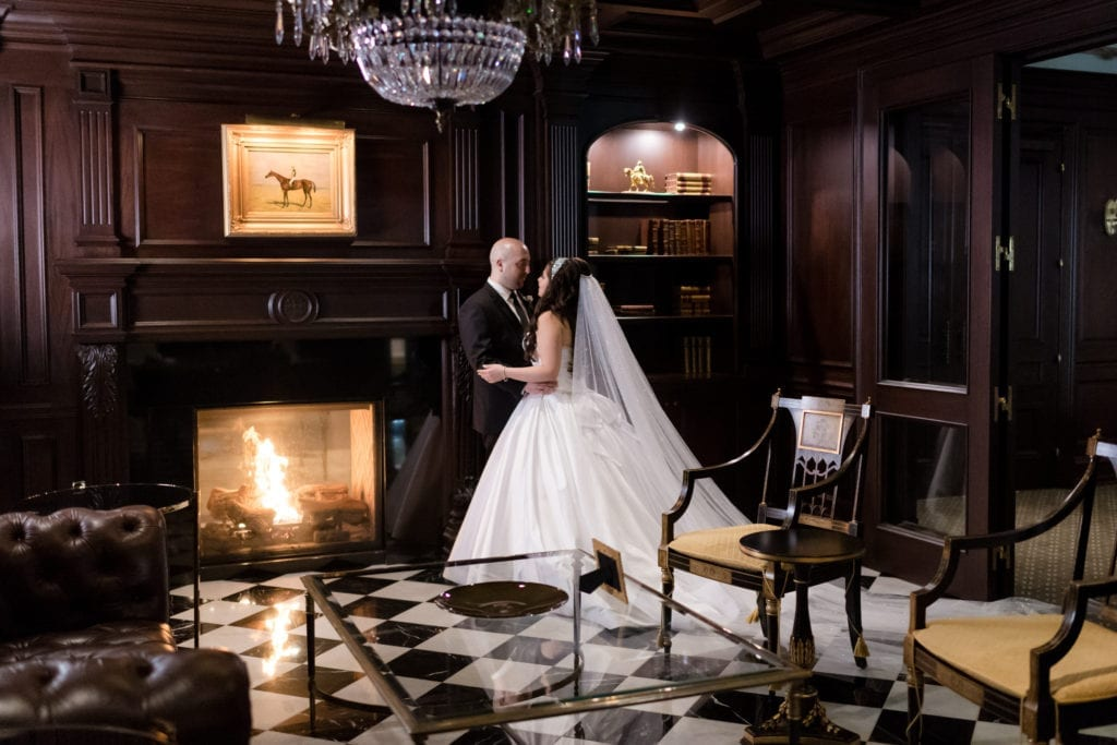 bride and groom at Park Chateau by the fireplace