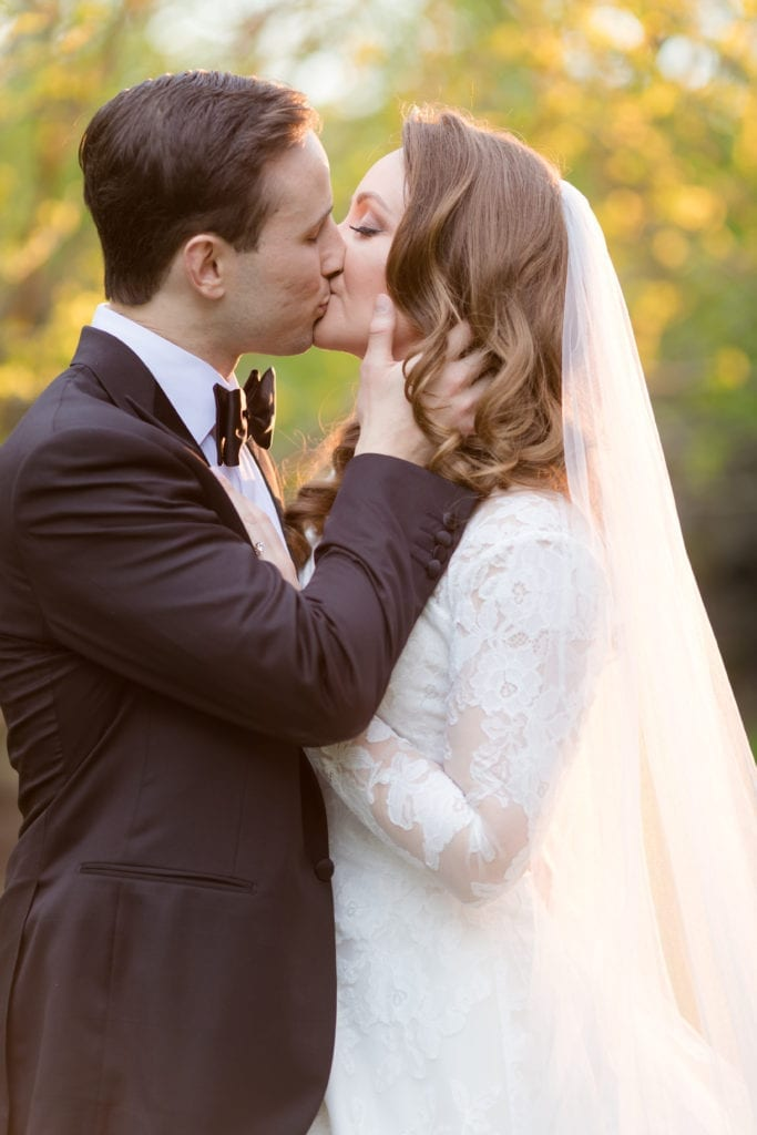 close up shot of bride and groom kissing