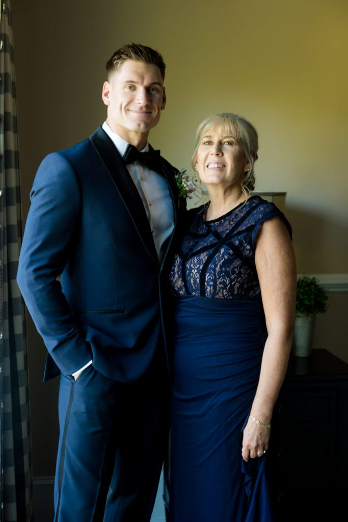 groom and his mother on wedding day, Navy and black tuxedo